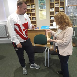 David showing his medal to Daventry Town Council Mayor Lynne Taylor at Daventry Museum