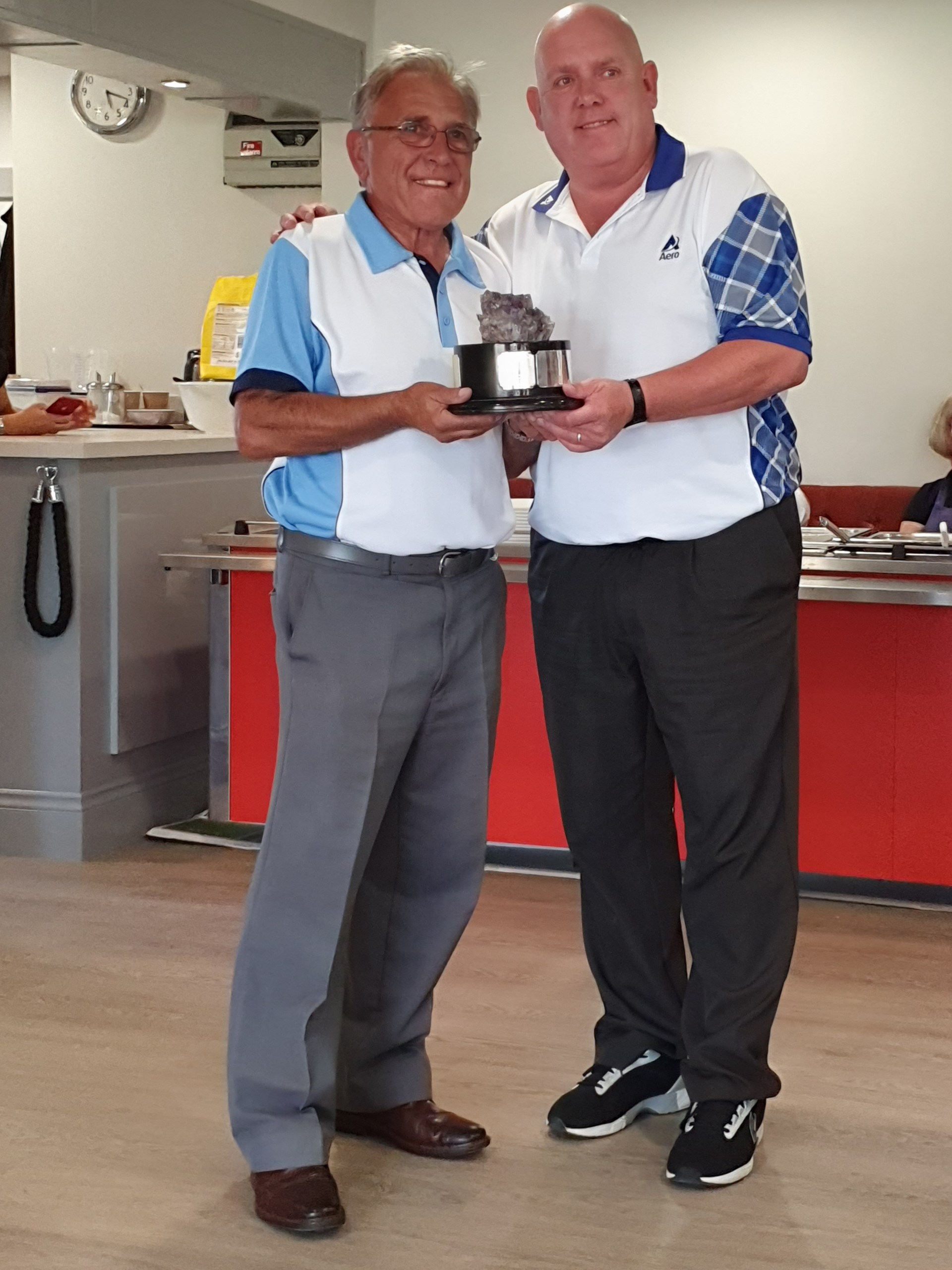 "Alex Marshall presenting the ""Jack Partridge Crystal Memorial Trophy"" to the winning Northampton Whyte Melville Bowls Club Captain Neville Bodily"