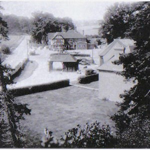 View of the Beach Arms and the garage showing the WW2 tank trap in the B3400