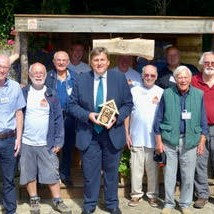 Photo of members of Oakley Men's Shed taken during the visit of Kit Malthouse MP