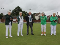 President Alan Guest hands over the green to Ladies president Joyce Lamb