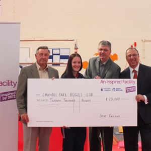 RECEIVING LOTTERY CHEQUE from The Sports England Inspired Facilities 2013