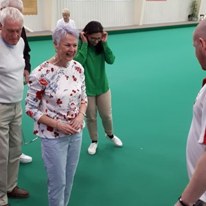 Another team being briefed on what happens in a bowls Gala
