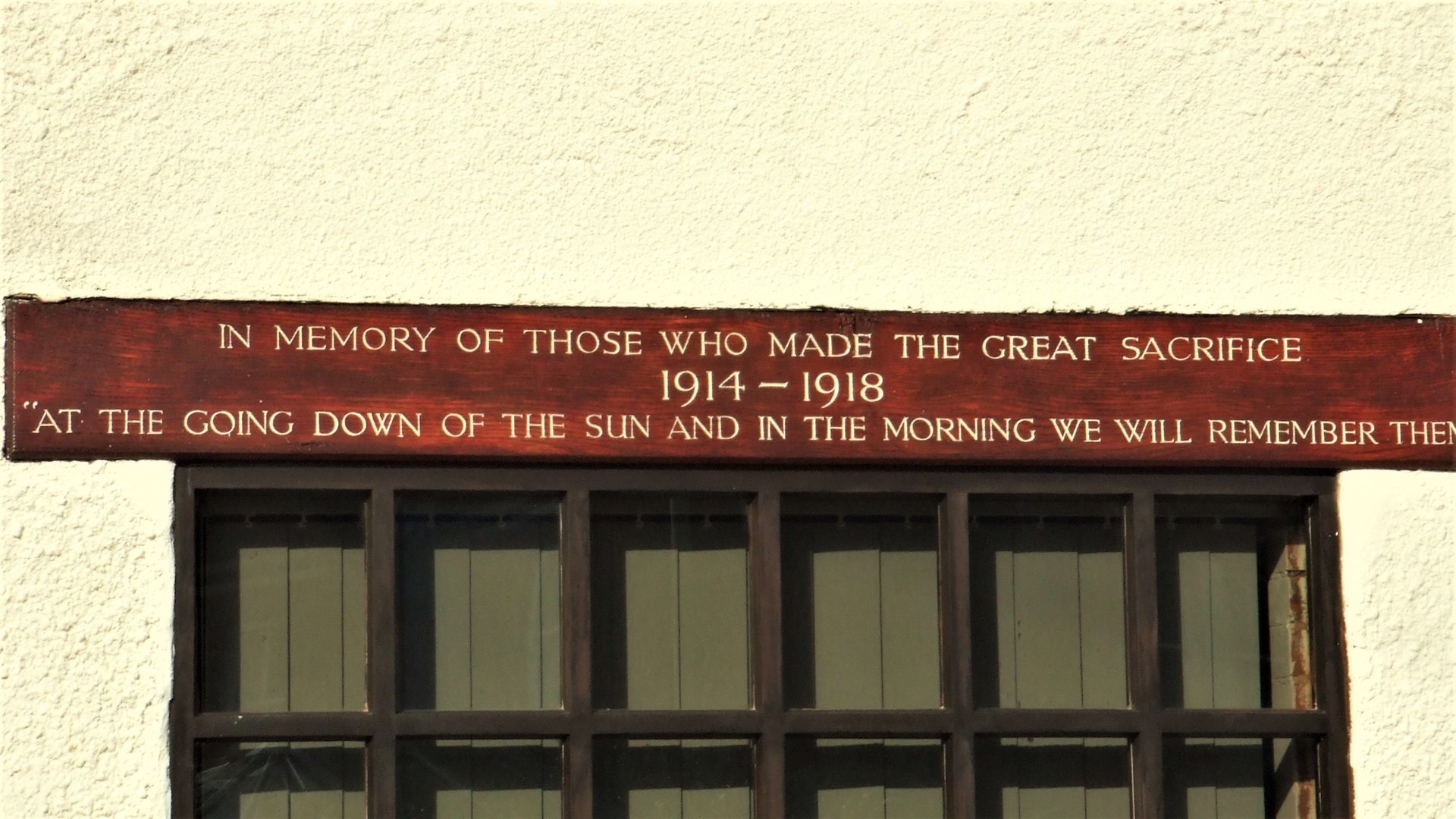 A memorial above the front facing Village Hall window