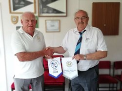 President Mal Croson exchanging pennants with Grimsby 23rd June 2018