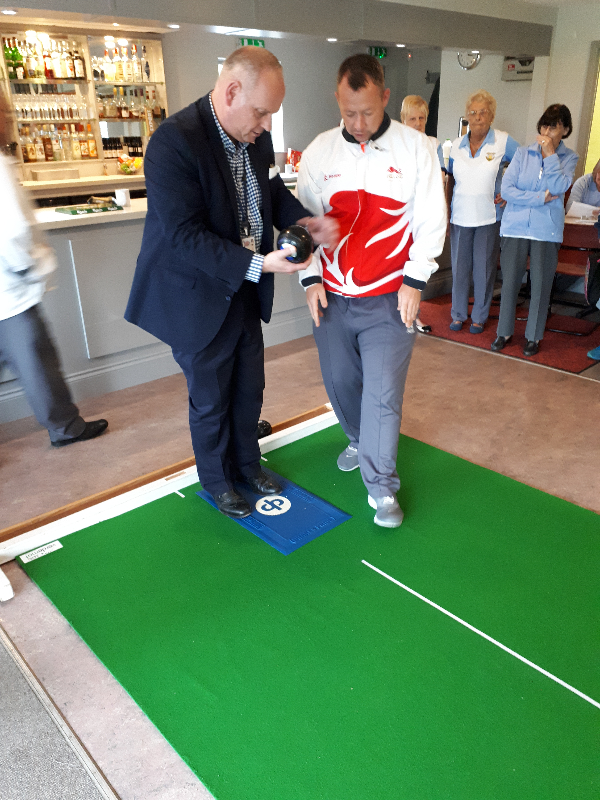 David Bolt explaining to Councillor Jonathan Nunn, Leader of Northampton Borough Council how to Bowl at Northampton Whyte Melville Bowls Club (Fernie Field, Moulton)