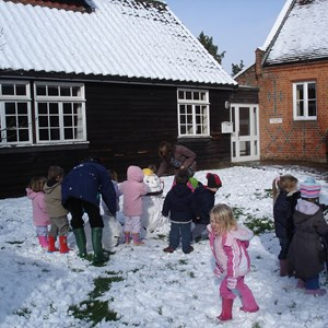 Playing in the snow at St Leonards Playschool