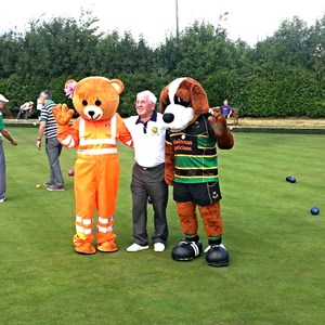 Daventry Town the venue for the first fun day with Duggie Mitchell the current Chairman of Daventry Town welcoming the Air Ambulance Mascot and Bernie the Northampton Saings Mascot to the Club