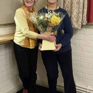 A thank you gift to our long-serving bookings secretary Sheena (r) from Chair Lally