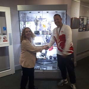 Daventry Town Council Mayor Lynne Taylor congratulating David on winning a Bronze Medal at CWG18