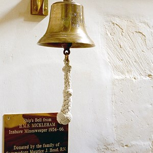The ship's bell from HMS Mickleham hangs in the church