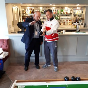Leader of Northampton Borough Council getting some Bowls Tips from David at Northampton Whyye Melville Bowls Club based at Fernie Fields in Moulton
