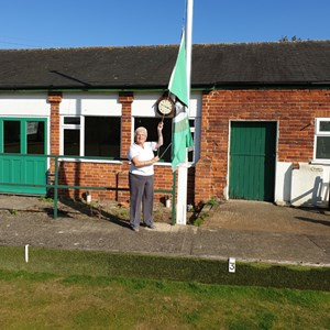 President Rachel Bonsor Lowering the Club Flag at the Closing of the Green