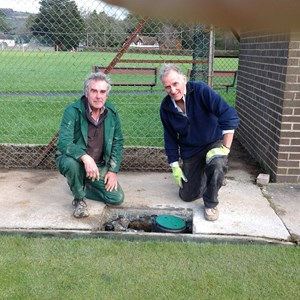 Headgreen Keeper Steve Callard with Dave Johnson installing pop-up watering system