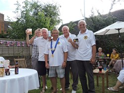 The winners with their bottle of Vodka (miniature)