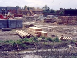 1986 Buildings rising from the Playing fields