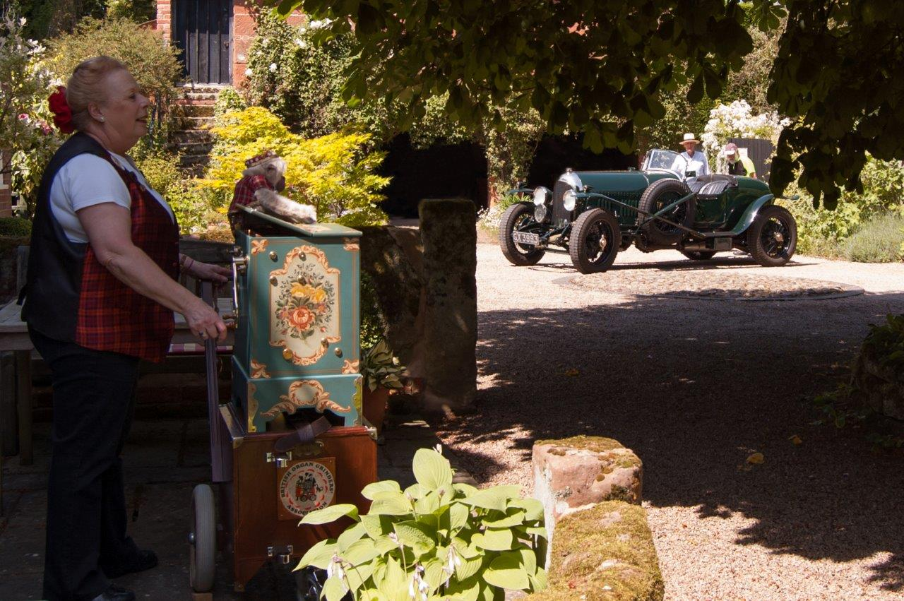 Gardens Open - 2018: Kathleen Turner with her barrel organ at Church Farmhouse
