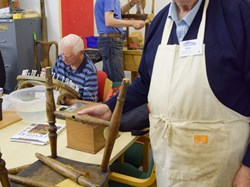 Ron restoring a chair