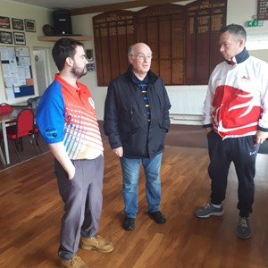 Willie updating David on the work the club does to promote bowls to the local community and schools with Alistair Melville an U25 County Bowler