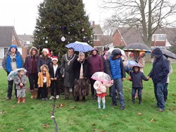 Tree decorating judging in the rain
