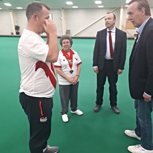 Chris Millar, leader of DDC congratulating David on his CWG18 medal success and thanking him for coming to Daventry to help promote Bowls and the indoor Bowls Club