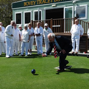 County Councillor bowling the first bowl to open the green 2016
