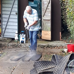 Norman - cleaning the ditch mats