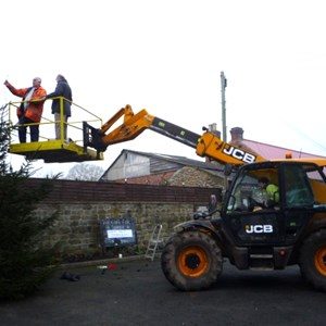 Erecting the Christmas Tree outside the Memorial Hall with help from James Stockdale, Roger Barker, Tony Groves, John Ridsdale, Erkan of the Londesborough Arms and Geoff Milner