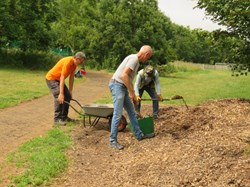 Improving the pathways with wood chip.