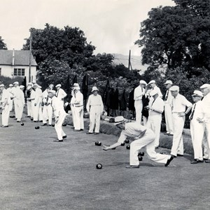 Representing the county. Vernon Caudle bowling, Jim Attwood 1st right. (hidden) George Robinson 5th right.