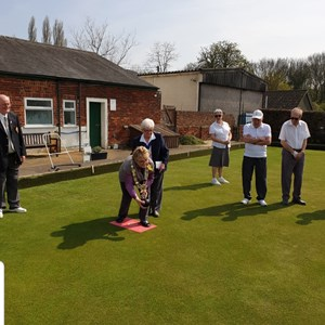 Mayor Sue Ayers delivering the first bowl to officially open the Green.