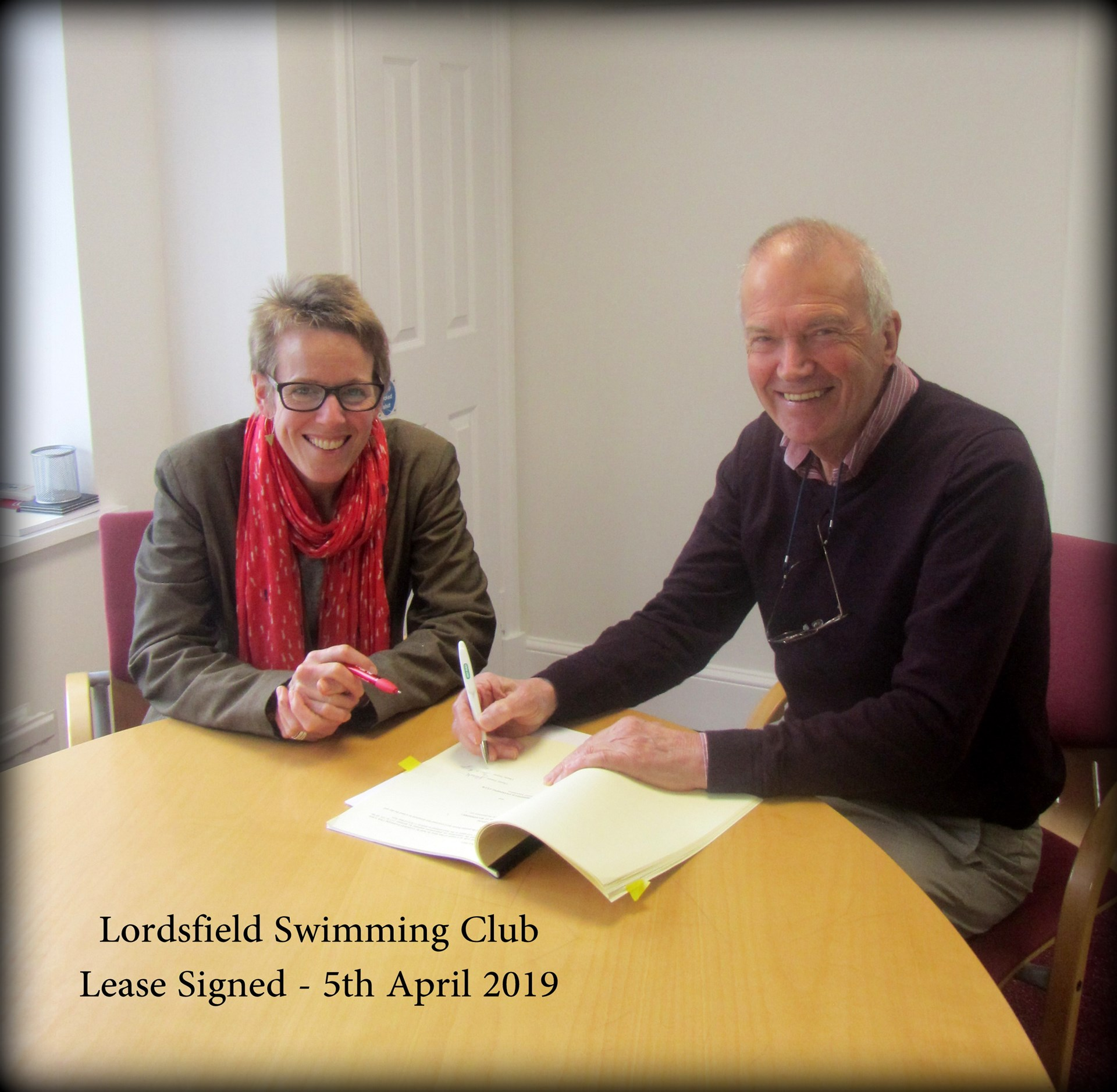 Tania Bridge & David Edwards signing the lease on the pool, 5 April 2019