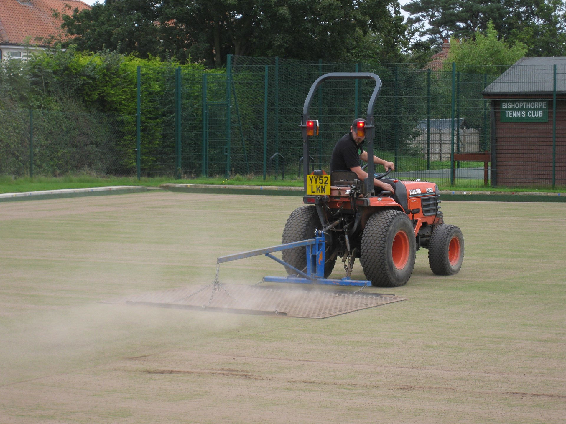 Drag-matting to re-level the surface.