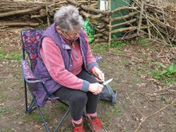 Learning the art of whittling.