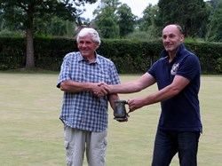 Match organiser Bob Mumford presents the mug to Much Wenlock Chairman, Peter Gyldard
