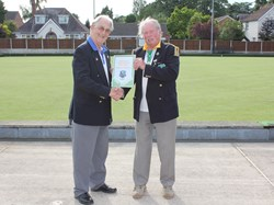 Treasurer Denis Smith presented with a framed pennant from Cullompton President Bruce Beaton