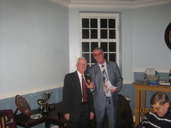 Club Captain Dennis Rolfe receiving trophy from Club President Brian Eastwood