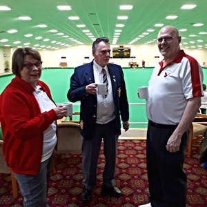"John, Bill and Marion enjoying a drink from ""Alison's Oven"" who provides excellent refreshments and food at the club for members and guests alike"