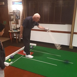 Mike Robins President of Daventry Town Bowling Club and Original Chairman of bowlsDAVENTRY showing Lewis how to use a bowling arm which allows Mike to keep on Bowling and competiting in a sport he has found in the last few years and loves playing