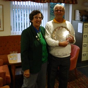 Pat Adams presents Brian Adams with the Section 8 Over 60 Singles Shield