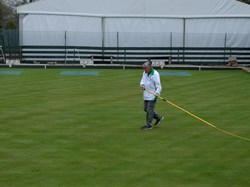 Steve Callard making finishing touches to the green just before the opening.