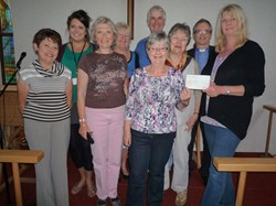 (L>R): Clare Kirby, Rachel Windebank, Karen Booker, Chris Smith, Bob Booker, Judy Nicholls, Delia Thomas, Rev Keith Underhill, Alice Neylon receiving cheque for Southern Domestic Abuse Service.