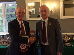 Derek Place (Left) receives his Special Award for long service to Bowls from Spencer Kerley Hon Sec Bowls Hampshire
