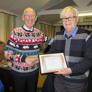 Eddie Rule presented with his honorary certificate