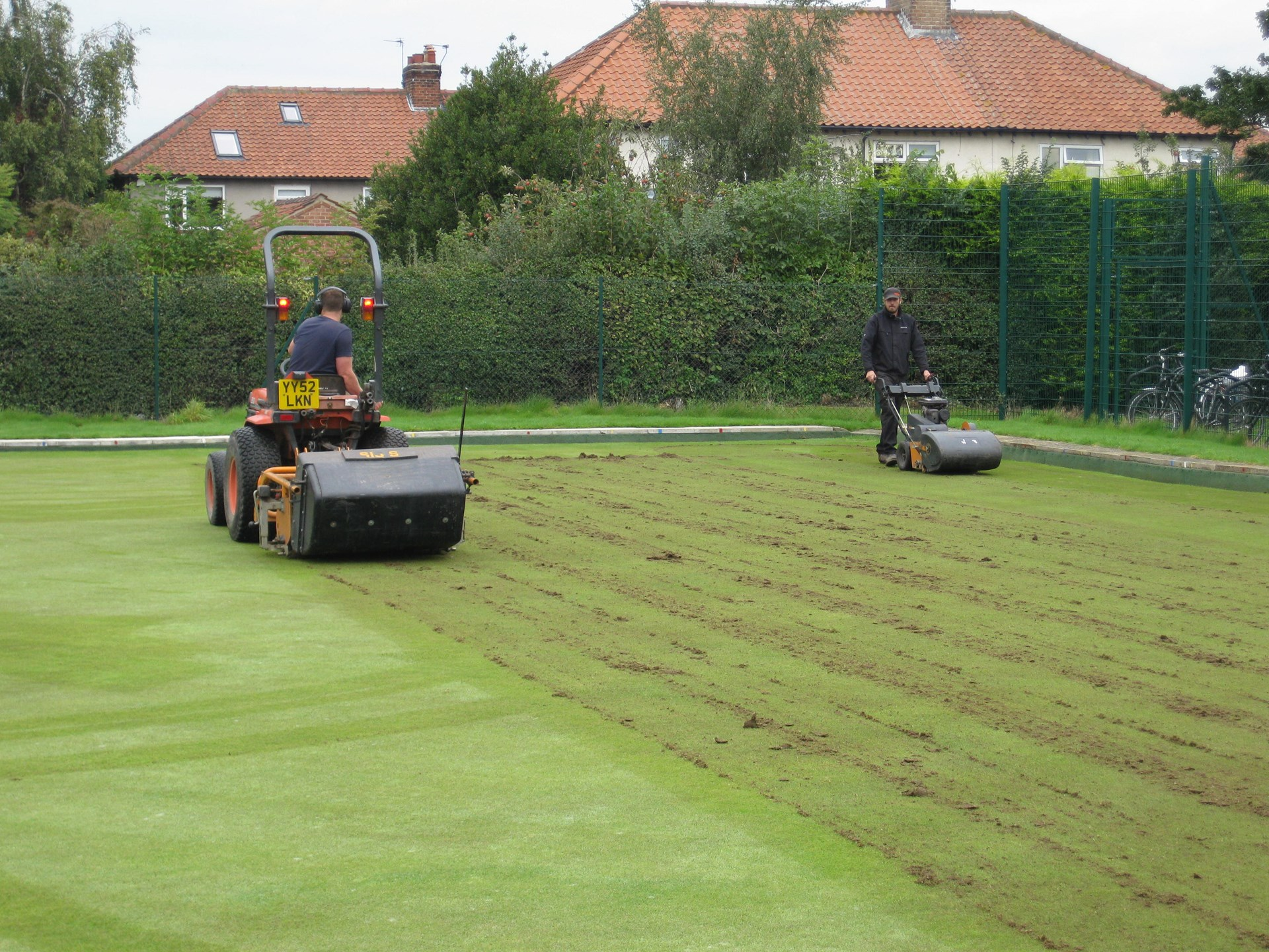 Deep scarifying and sweeping up the debris.