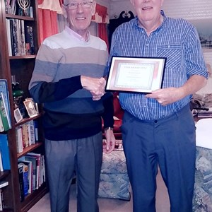 Mike Drakeford receives his honorary certificate from President Paul Carty