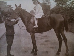 Elodie being treated to a horse ride, Station Road c 1915
