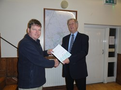 Jack Wilson presenting the certificate to Chairman, Peter Slark.