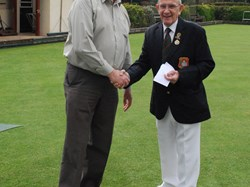 Vice Captain Bob Gregory receives his badge.