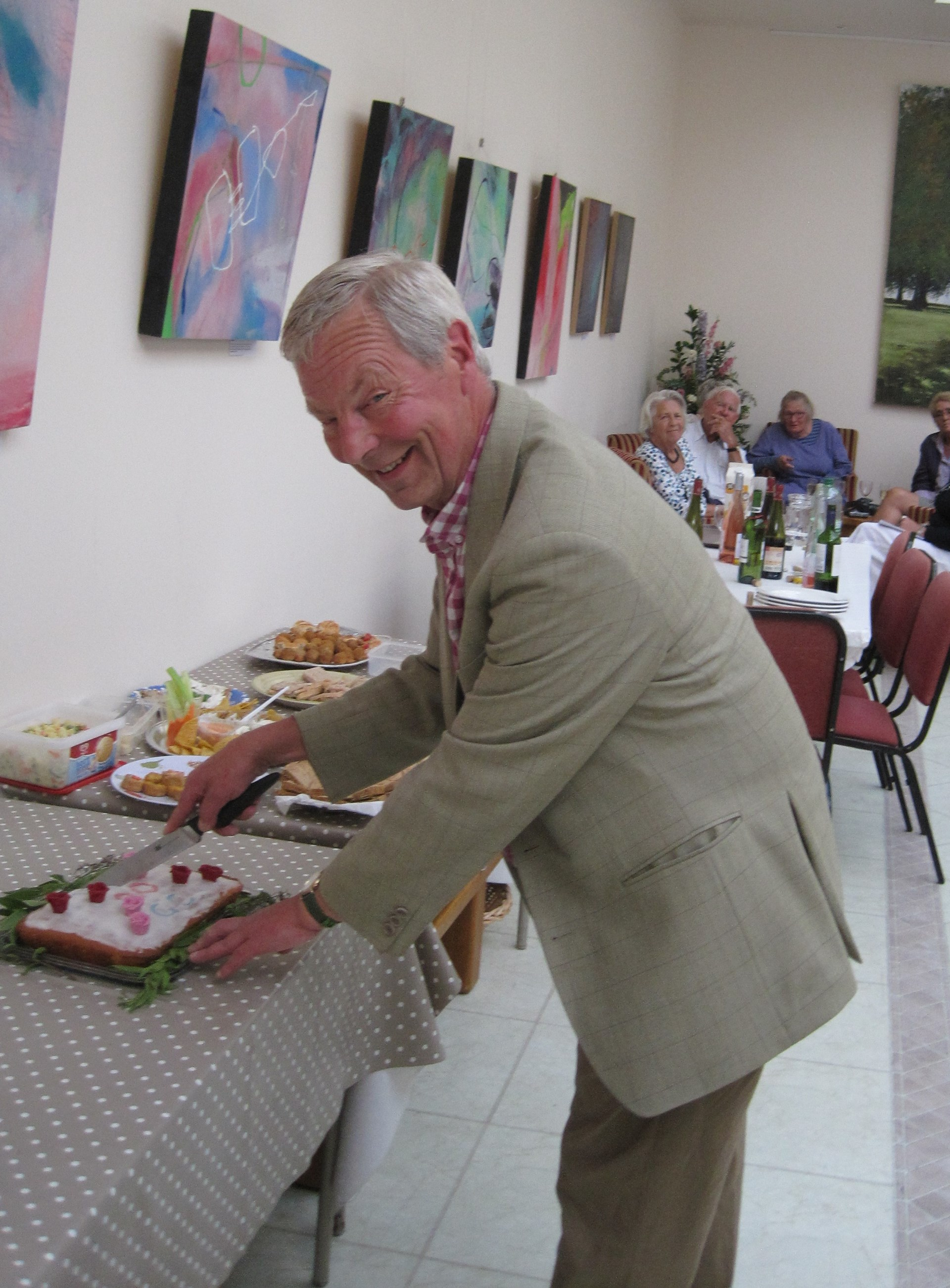 the chairman cuts the cake for the club's 20th  birthday
